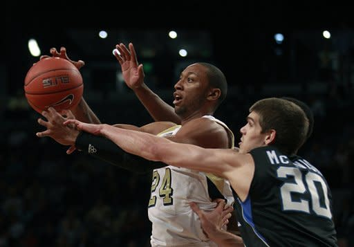 Georgia Tech forward Kammeon Holsey (24) catches a pass as Presbyterian guard Ryan McTavish (20) defends in the first half of an NCAA college basketball game on Wednesday, Nov. 14, 2012, in Atlanta. (AP Photo/John Bazemore)