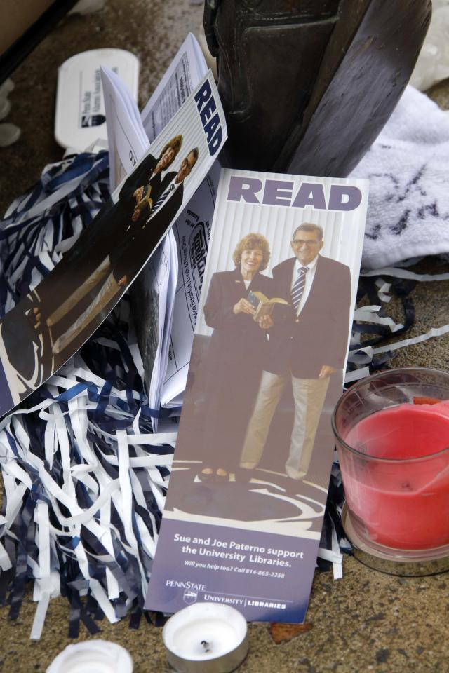 Cards featuring Joe Paterno and wife Sue are displayed at the foot of a statue of Joe outside Beaver Stadium on the Penn State University campus on Sunday, Jan. 22, 2012, in State College,Pa. Former Penn State football coach Joe Paterno died Sunday at the age of 85. (AP Photo/Gene J. Puskar)