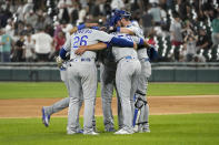 The Kansas City Royals celebrate the team's 3-2 win over the Chicago White Sox after a baseball game Thursday, Aug. 5, 2021, in Chicago. (AP Photo/Charles Rex Arbogast)