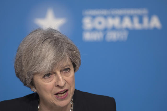 British Prime Minster Theresa May listens during the London Somalia Conference, held at Lancaster House, in London, Thursday, May 11, 2017. May and U.N. Secretary-General Antonio Guterres called Thursday for more support for drought-stricken Somalia, with the U.N. chief requesting another $900 million in aid this year. (Jack Hill/Pool Photo via AP)
