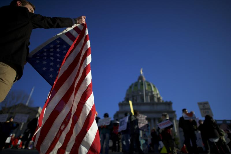 Protesters demonstrate outside the Pennsylvania Capitol in Harrisburg in December 2016. (Mark Makela via Getty Images)