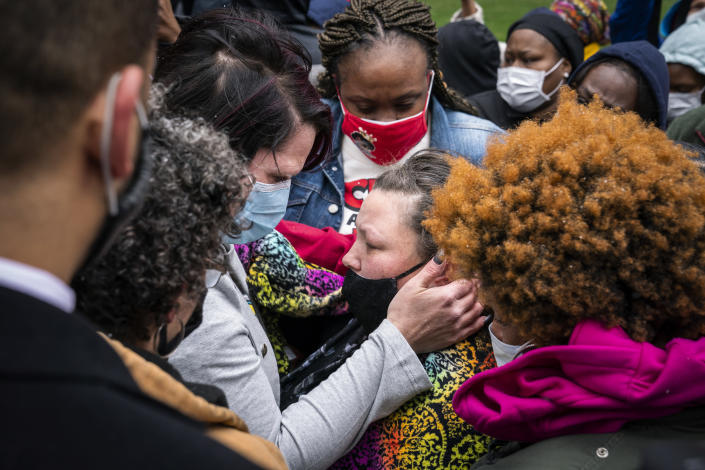 Katie Wright, center right, the mother of Daunte Wright, is embraced by George Floyd's girlfriend, Courteney Ross, center left, before a news conference outside the Hennepin County Government Center on Tuesday, April 13, 2021, in Minneapolis. (Leila Navidi/Star Tribune via AP)