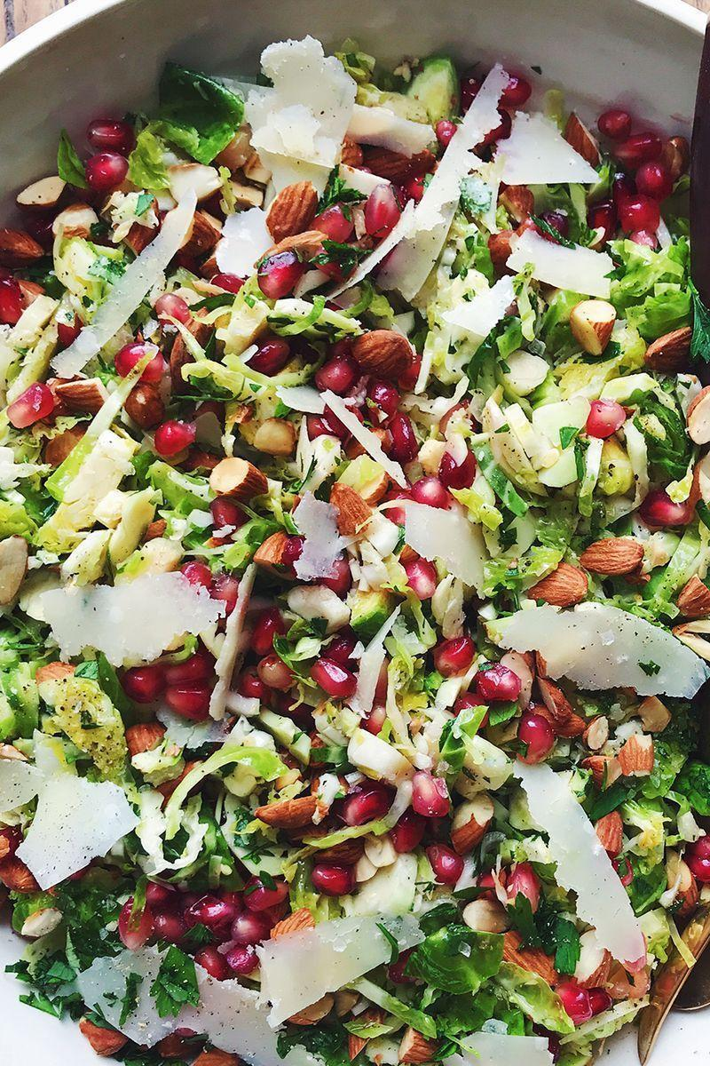 """<p>Making a Brussels sprouts salad sounds intimidating, but it doesn't actually require much prep. Tossed with a combo of toasted almonds, shaved Parmesan, and pomegranate seeds, it's the best side for any get-together. </p><p>Get the <a href=""""https://www.delish.com/uk/cooking/recipes/a29696085/brussels-sprouts-salad-recipe/"""" rel=""""nofollow noopener"""" target=""""_blank"""" data-ylk=""""slk:Parmesan Brussels Sprouts Salad"""" class=""""link rapid-noclick-resp"""">Parmesan Brussels Sprouts Salad</a> recipe.</p>"""