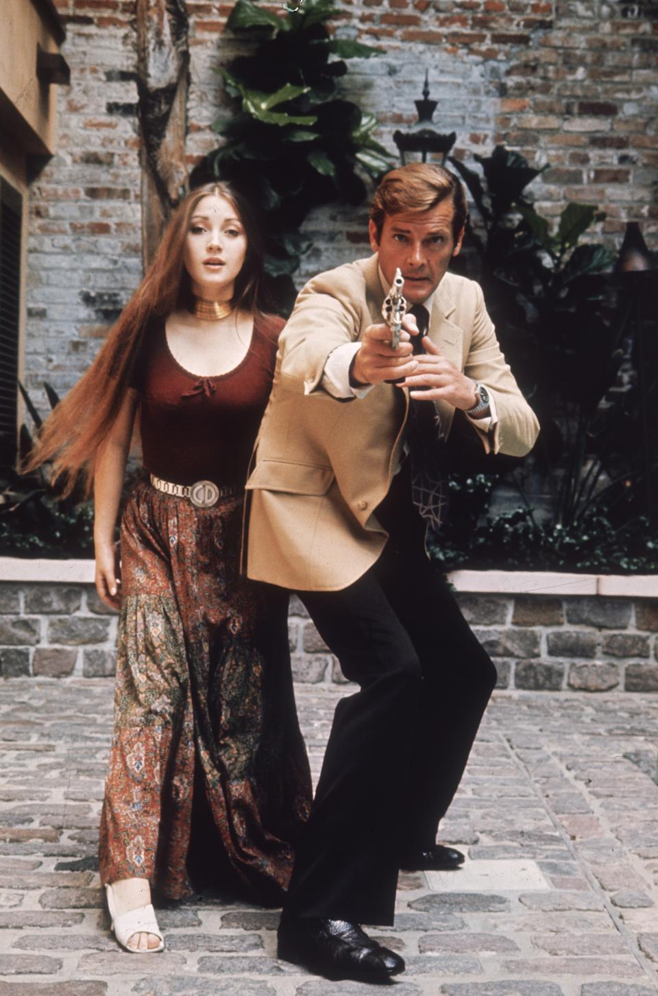 1973: Jane Seymour plays the clairvoyant Solitaire to Roger Moore's 007 in the James Bond film 'Live and Let Die', directed by Guy Hamilton.  (Photo by Keystone/Getty Images)