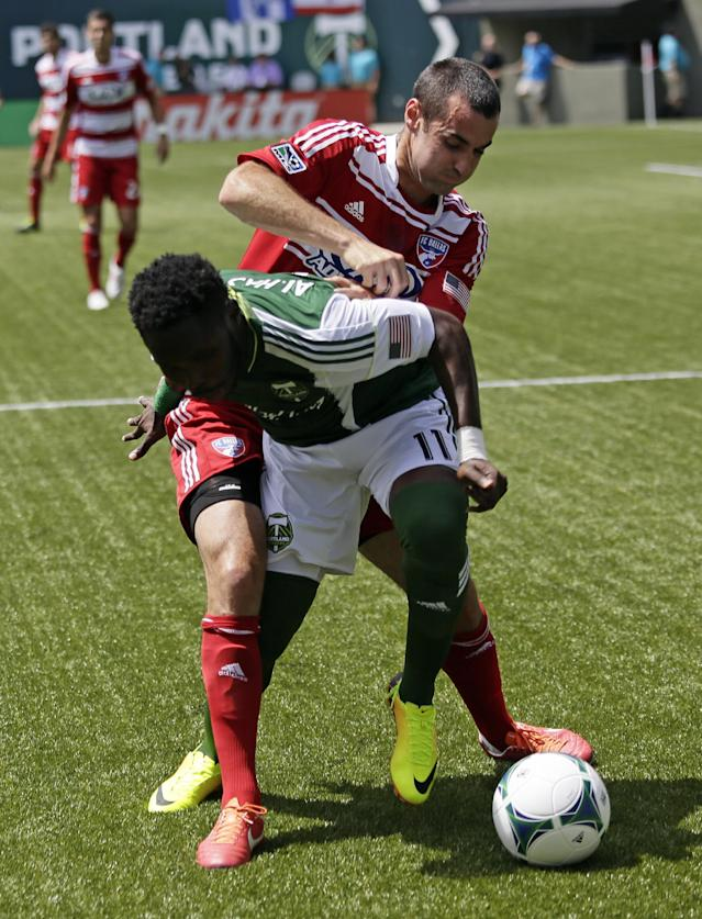 Portland Timbers forward Kalif Alhassan, front, battles for the ball with FC Dallas defender Matt Hedges during the first half of an MLS soccer game in Portland, Ore., Saturday, June 15, 2013. (AP Photo/Don Ryan)