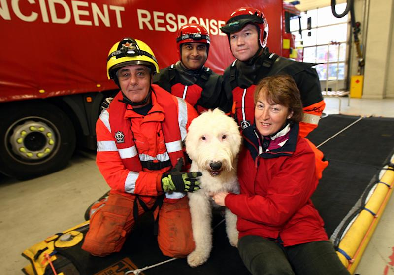 'Monty' the Old English sheepdog with owner Heather Baker (right) and the team from Leicestershire Fire and rescue today.