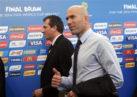Former France soccer player Zinedine Zidane (R) arrives for the draw for the 2014 World Cup at the Costa do Sauipe resort in Sao Joao da Mata, Bahia state, December 6, 2013. REUTERS/Ricardo Moraes
