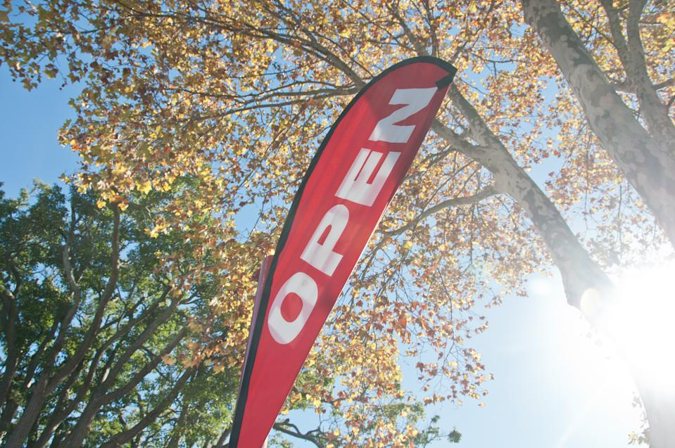 Red Open House for Sale/Rent signage in Autumn