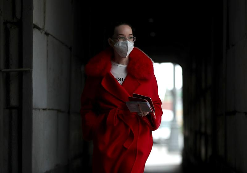 MOSCOW, RUSSIA - MAY 19, 2020: A young girl in a protective mask seen on a city street. The Moscow authorities have extended the self-isolation regime through May 31 to prevent the spread of the novel coronavirus. Mikhail Tereshchenko/TASS (Photo by Mikhail Tereshchenko\TASS via Getty Images)