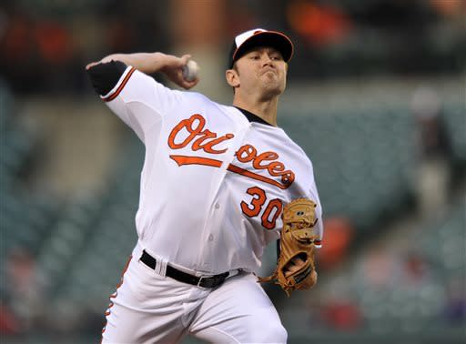 Baltimore Orioles starting pitcher Chris Tillman throws against the Toronto Blue Jays in the first inning of a baseball game Monday, April 22, 2013 in Baltimore. (AP Photo/Gail Burton)