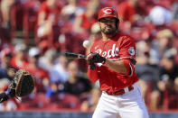 Cincinnati Reds' Eugenio Suarez reacts as he is hit by a pitch during the third inning of a baseball game against the Colorado Rockies in Cincinnati, Saturday, June 12, 2021. (AP Photo/Aaron Doster)