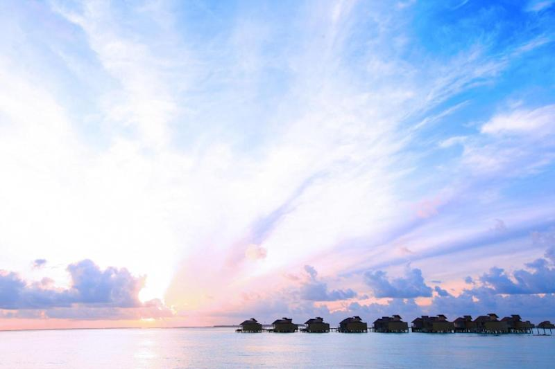 The water villas at sunset