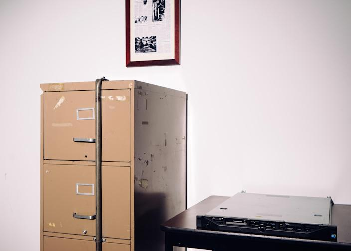 A server breached by Russian hackers in 2016, beside a filing cabinet broken into during the Watergate burglary in 1972 in the basement of the Democratic national headquarters building in Washington on Dec. 12, 2016. (Justin T. Gellerson/The New York Time