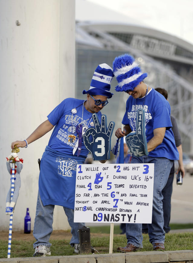 Kentucky fans make their way to AT&T Stadium before the NCAA Final Four tournament college basketball championship game against Connecticut Monday, April 7, 2014, in Arlington, Texas. (AP Photo/Eric Gay)