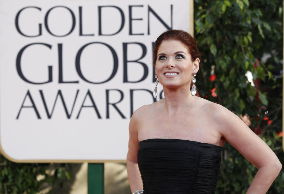 """Actress Debra Messing, from the sitcom """"Hot in Cleveland,"""" arrives at the 70th annual Golden Globe Awards in Beverly Hills, California, January 13, 2013.  REUTERS/Mario Anzuoni (UNITED STATES  - Tags: ENTERTAINMENT)  (GOLDENGLOBES-ARRIVALS)"""