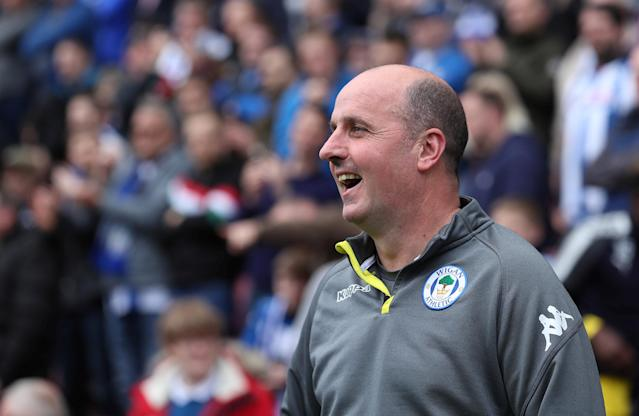 """Soccer Football - League One - Wigan Athletic v AFC Wimbledon - DW Stadium, Wigan, Britain - April 28, 2018 Wigan Athletic's manager Paul Cook before kick off Action Images/John Clifton EDITORIAL USE ONLY. No use with unauthorized audio, video, data, fixture lists, club/league logos or """"live"""" services. Online in-match use limited to 75 images, no video emulation. No use in betting, games or single club/league/player publications. Please contact your account representative for further details."""