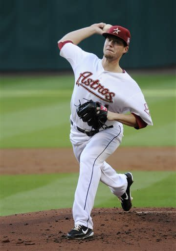 Houston Astros' Lucas Harrell delivers a pitch against the Colorado Rockies in the third inning of a baseball game Saturday, April 7, 2012, in Houston. (AP Photo/Pat Sullivan)