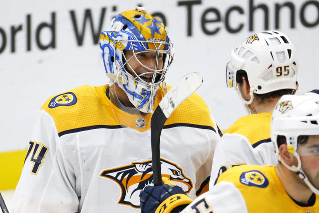 Nashville Predators goaltender Juuse Saros, of Finland, is congratulated by teammates after the Predators defeat the St. Louis Blues in an NHL hockey game Saturday, Feb. 15, 2020, in St. Louis. (AP Photo/Billy Hurst)