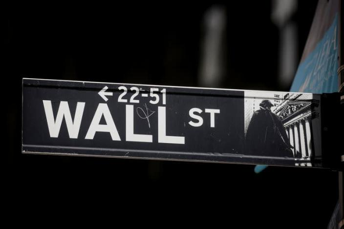 The Wall St. sign is seen near the NYSE in New York