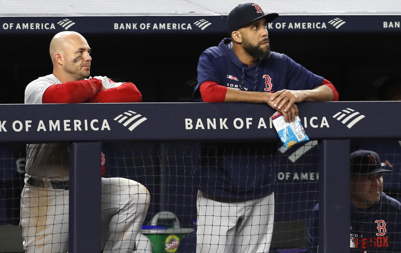 Boston Red Sox Steve Pearce, left, and Red Sox starting pitcher David Price watch from the dugout during the ninth inning of the Red Sox 5-3 loss to the New York Yankees in a baseball game, Wednesday, April 17, 2019, in New York. (AP Photo/Kathy Willens)