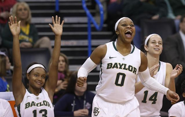 Baylor forward Nina Davis (13), guard Odyssey Sims (0) and guard Makenzie Robertson (14) celebrate on the bench in the second half of an NCAA college basketball game against Kansas in the quarterfinals of the Big 12 Conference women's college tournament in Oklahoma City, Saturday, March 8, 2014. Baylor won 81-47. (AP Photo/Sue Ogrocki)