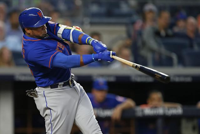 <p>New York Mets' Yoenis Cespedes hits a home run against the New York Yankees during the third inning of a baseball game, Monday, Aug. 14, 2017, at Yankee Stadium in New York. (AP Photo/Rich Schultz) </p>