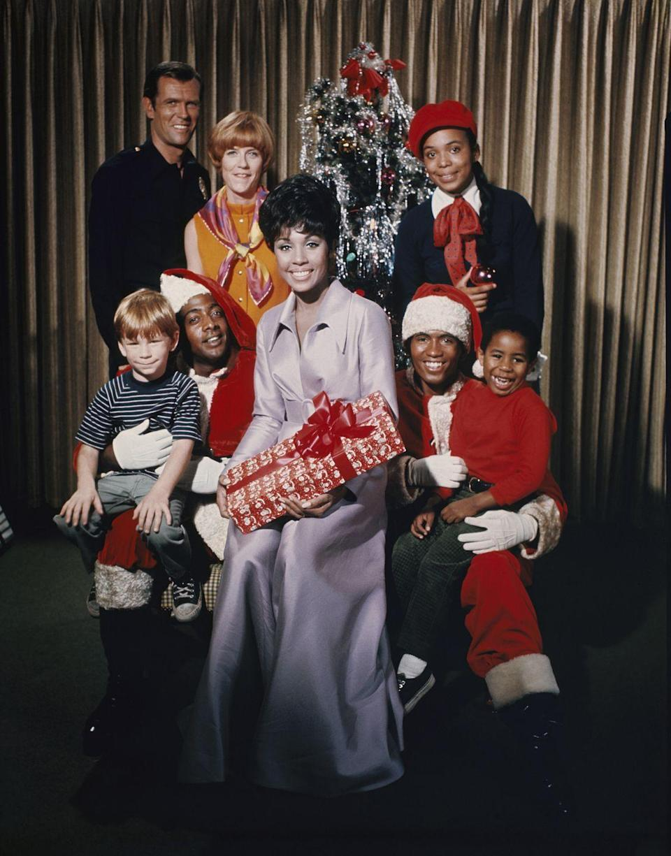 <p>Star of the hit television series, <em>Julia, </em>Diahann Carroll takes part in a seasonal promotional photoshoot with her costars. </p>