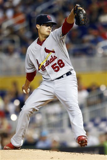 St. Louis Cardinals starter Joe Kelly throws to the Miami Marlins during second the inning of a baseball game in Miami, Wednesday, June 27, 2012. (AP Photo/J Pat Carter)