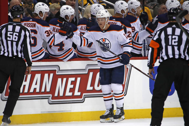 Edmonton Oilers' Colby Cave (12) returns to the bench after scoring during the second period of an NHL hockey game against the Pittsburgh Penguins in Pittsburgh, Saturday, Nov. 2, 2019. (AP Photo/Gene J. Puskar)