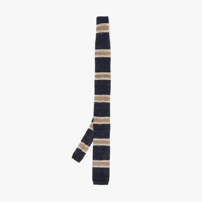 """$280, MATCHESFASHION.COM. <a href=""""https://www.matchesfashion.com/us/products/Brunello-Cucinelli-Striped-cotton-and-linen-blend-knitted-tie-1402582"""" rel=""""nofollow noopener"""" target=""""_blank"""" data-ylk=""""slk:Buy Now"""" class=""""link rapid-noclick-resp"""">Buy Now</a><br>"""
