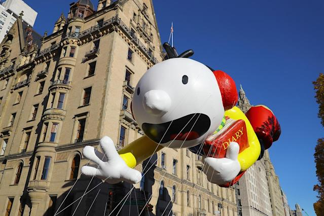 "<p>The ""Diary of a Wimpy Kid"" Greg Heffley balloon is led down Central Park West in the 91st Macy's Thanksgiving Day Parade in New York, Nov. 23, 2017. (Photo: Gordon Donovan/Yahoo News) </p>"