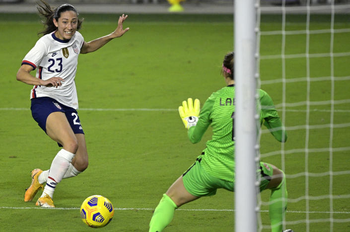 United States forward Christen Press (23) attempts a shot that is blocked by Canada goalkeeper Stephanie Labbe (1) during the second half of a SheBelieves Cup women's soccer match, Thursday, Feb. 18, 2021, in Orlando, Fla. (AP Photo/Phelan M. Ebenhack)
