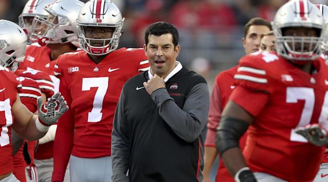 Ryan Day (middle) will try to keep Ohio State undefeated while Urban Meyer serves his suspension. (AP)