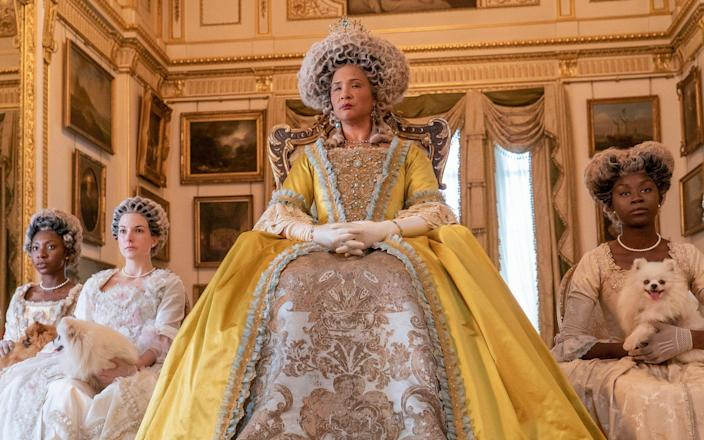 """255750345 / f467a92e-cdd0-30a3-beb7-b95c11d21370 Original description: This image released by Netflix shows Golda Rosheuvel as Queen Charlotte, center, in the romance series """"Bridgerton."""" Television producers Shonda Rhimes and Betsy Beers will be honored for their wardrobe efforts on projects like """"Grey's Anatomy"""" and """"Bridgerton"""" at the Costume Designers Guild Awards. (Liam Daniel/Netflix via AP) Image title: CDGA Collaborator Award Credit: Liam Daniel Source: Netflix Filename: TELEMMGLPICT000255750345.jpeg - Liam Daniel/Netflix via AP"""