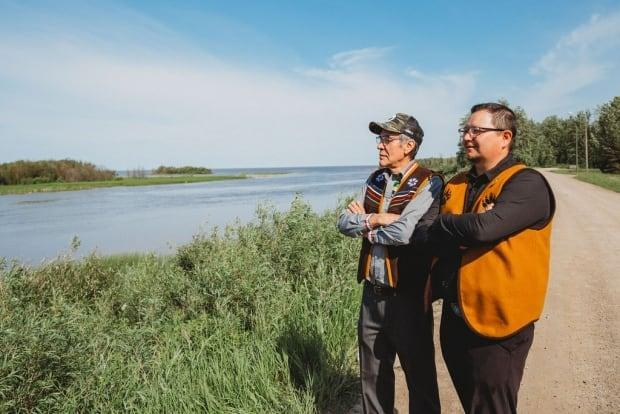 Dene National Chief Norman Yakeleya with Kenny Cayen, grand chief of Dehcho First Nations at the West Point First Nation Treaty 11 celebrations earlier this month. This summer, people across the N.W.T. are marking 100 years since the treaty was signed.  (Nicole Wang for CBC North - image credit)
