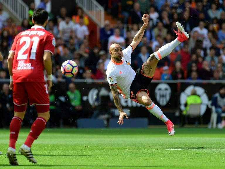 Valencia's forward Simone Zaza jumps to kick the ball during the Spanish league football match Valencia CF vs Sevilla FC at the Mestalla stadium in Valencia on April 16, 2017