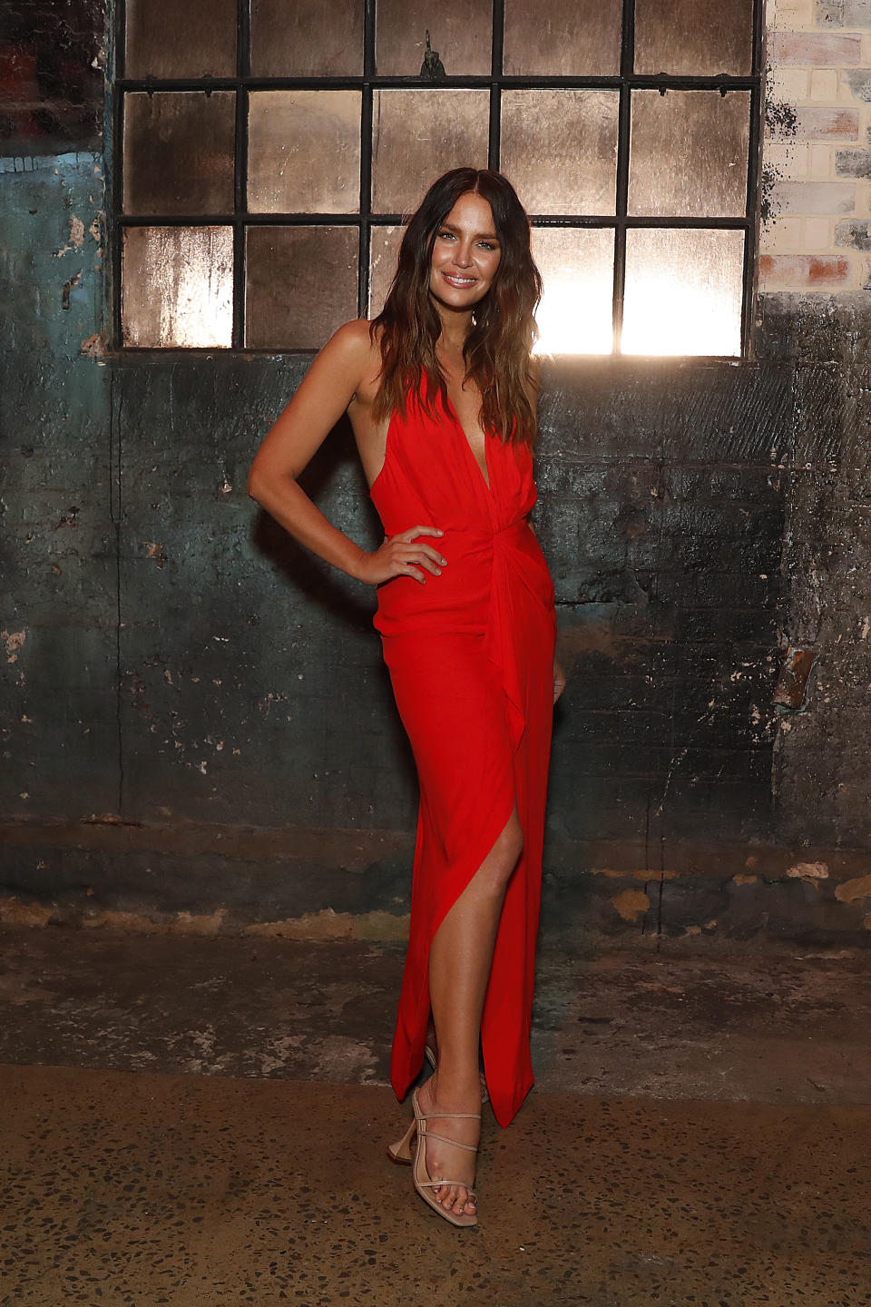 Jodi Gordon wears a bright red dress at the Manning Cartell show during Afterpay Australian Fashion Week 2021 Resort '22 Collections at Carriageworks on June 03, 2021 in Sydney, Australia