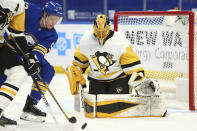 Buffalo Sabres forward Jeff Skinner (53) is stopped by Pittsburgh Penguins goalie Casey DeSmith (1) during the first period of an NHL hockey game, Sunday, April 18, 2021, in Buffalo, N.Y. (AP Photo/Jeffrey T. Barnes)