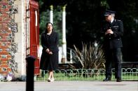 Britain's Home Secretary Priti Patel and Thames Valley Police Chief Constable, John Campbell are pictured near to the scene of reported multiple stabbings in Reading