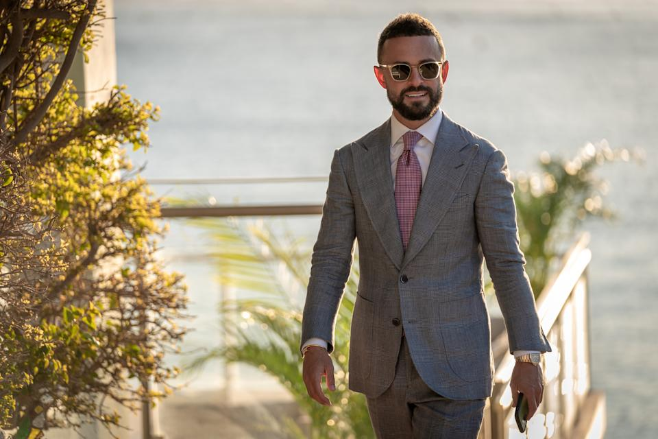 Gavin Rubinstein in a suit and sunglasses on Luxe Listings Sydney