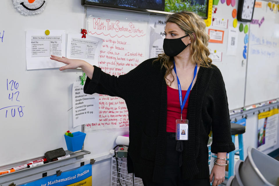 Grace Kern, a substitute teacher at the Greenfield Intermediate School in Greenfield, Ind., is shown Thursday, Dec. 10, 2020. Kern, a student at IUPUI in Indianapolis, is one of several college students being recruited to work as substitute teachers in schools during the pandemic. (AP Photo/Michael Conroy)