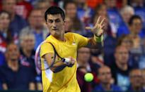 Australia's Bernard Tomic hits a return during his reverse singles match against Andy Murray of Great Britain in Davis Cup semi-final in Glasgow on September 20, 2015 (AFP Photo/Ian MacNicol)