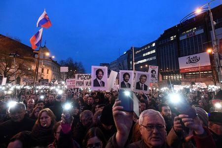 """FILE PHOTO: Demonstrators attend a protest called """"Let's stand for decency in Slovakia"""" in reaction to the murder of Slovak investigative reporter Jan Kuciak and his fiancee Martina Kusnirova, in Bratislava, Slovakia March 9, 2018. REUTERS/Radovan Stoklasa"""