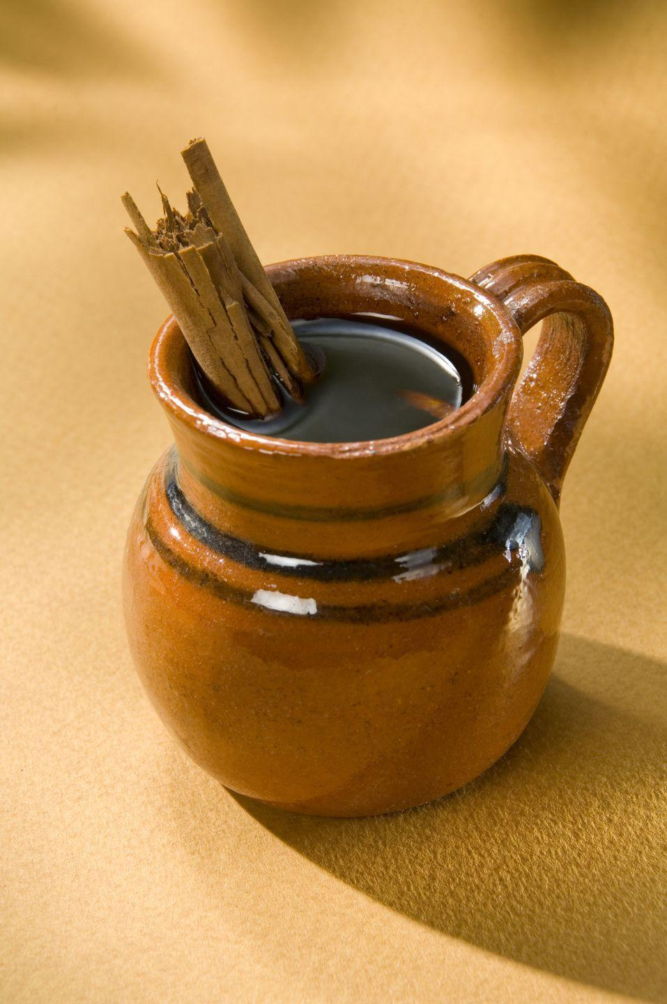 "<p>Café de olla is a Mexican coffee traditionally prepared in an earthen pot with ground coffee, cinnamon, and raw dark sugar called piloncillo. Other optional elements include cloves, star anise, and orange rind. </p><p><strong>Pro tip: </strong>This sweet, spicy brew is great for the winter months, but can also be enjoyed year-round. <br></p><p><em><a href=""https://www.mexicoinmykitchen.com/cafe-de-olla-recipe/"" rel=""nofollow noopener"" target=""_blank"" data-ylk=""slk:Get the recipe for Mexican Coffee from Mexico in my Kitchen »"" class=""link rapid-noclick-resp"">Get the recipe for Mexican Coffee from Mexico in my Kitchen »</a></em></p>"