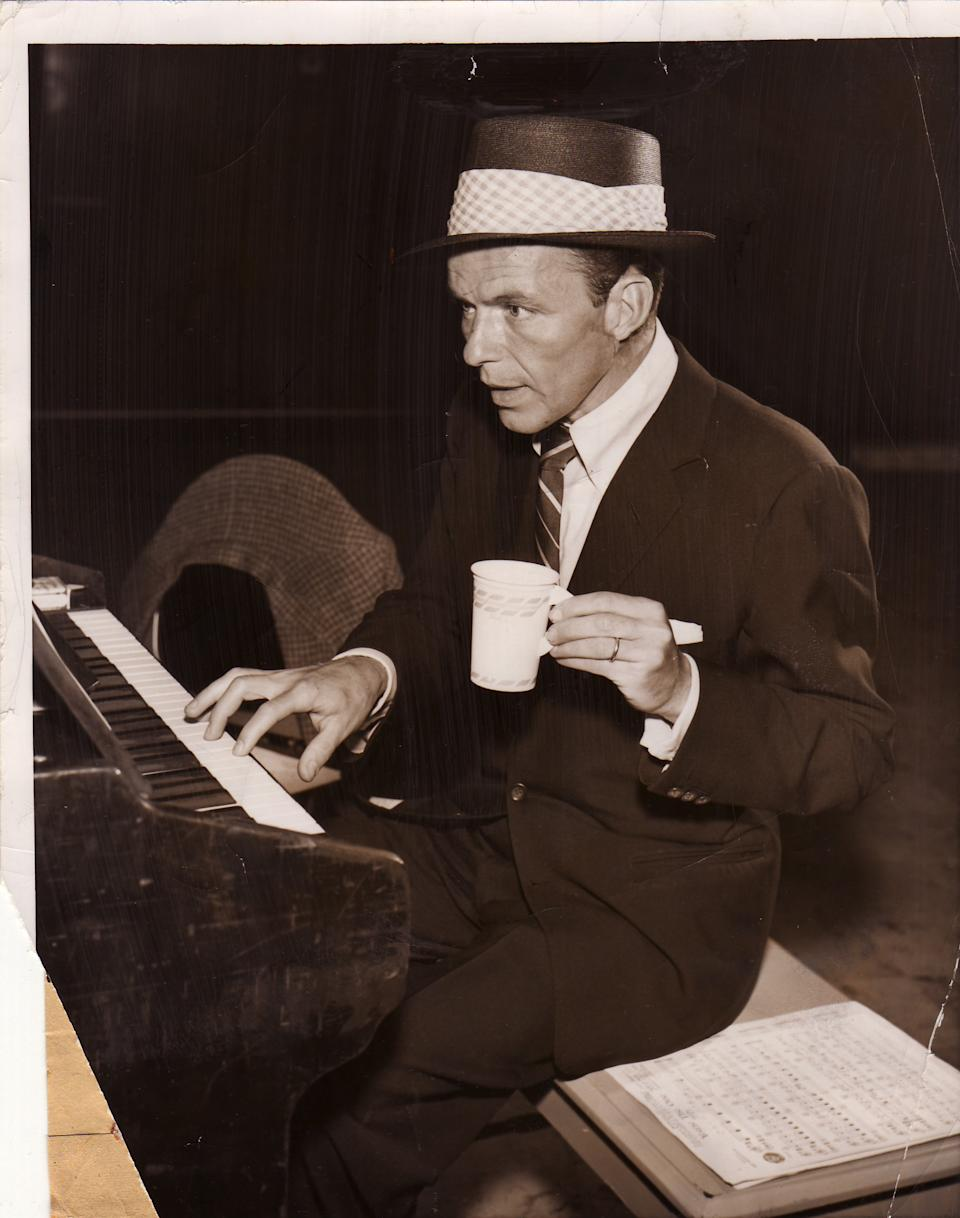 Frank Sinatra always wore a suit, tie and hat when he hit the recording studio. (Photo by Gilles Petard/Redferns)