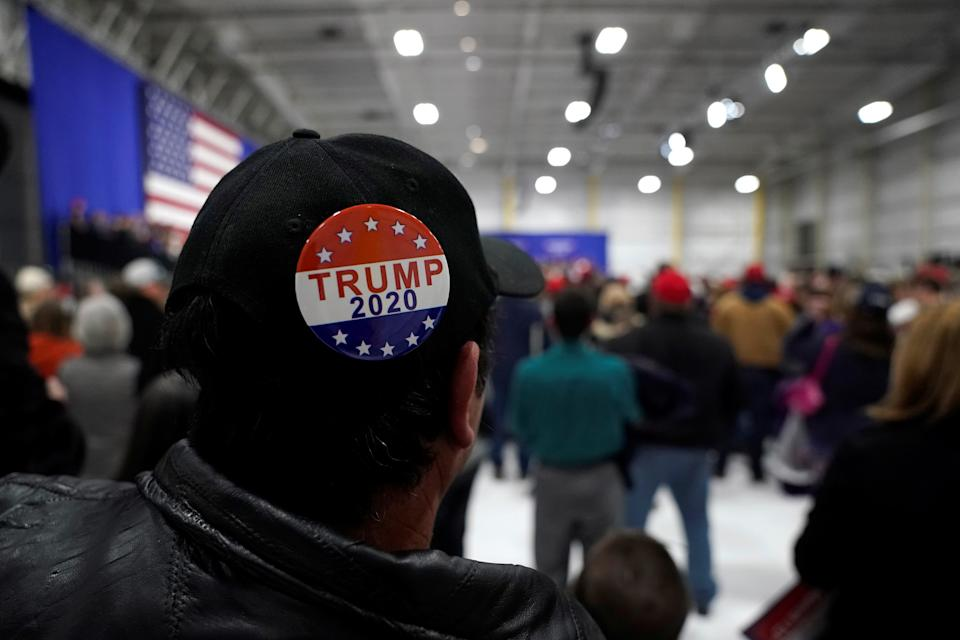 A man wears a Trump 2020 campaign button as U.S. President Donald Trump speaks in support of Republican congressional candidate Rick Saccone during a Make America Great Again rally in Moon Township, Pennsylvania, U.S., March 10, 2018.      REUTERS/Joshua Roberts
