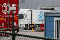 A refrigerated truck is seen on the back side of the Pfizer factory in Puurs