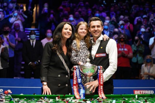Mark Selby posses with his wife and daughter after winning the world title