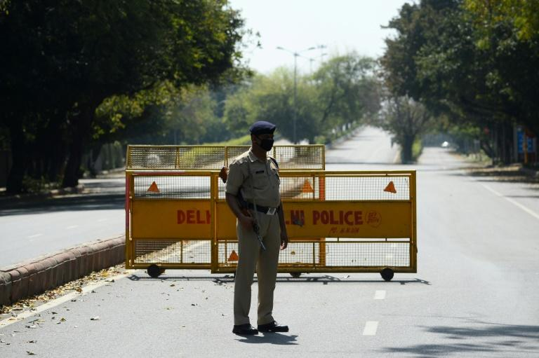 Reports of attacks and abuse of India's frontline health and transportation workers have increased with the imposition of a 21-day nationwide lockdown (AFP Photo/Sajjad HUSSAIN                      )