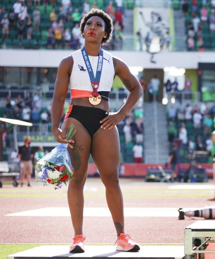 EUGENE, OREGON – JUNE 26: Gwendolyn Berry (L), third place, looks on during the playing of the national anthem with DeAnna Price (C), first place, and Brooke Andersen, second place, on the podium after the Women's Hammer Throw final on day nine of the 2020 U.S. Olympic Track & Field Team Trials at Hayward Field on June 26, 2021 in Eugene, Oregon. (Photo by Patrick Smith/Getty Images)